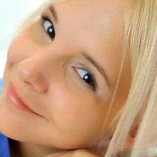 very cute blonde teen is masturbating on her clitoris