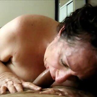 Brunette grandma eating dick
