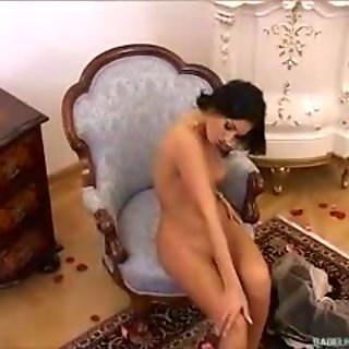 Nasty dark haired babe with big tits in black dress rubbing her swalen cunt