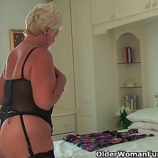 Chubby granny with big tits wears black stockings and masturbates