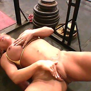 Dirty Blonde Masturbates Her Clit in the Gym