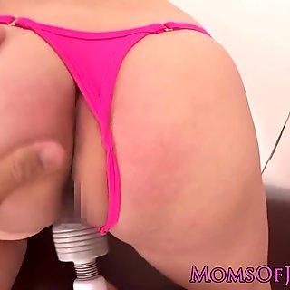 Teasing Japanese MILF hairy clit vibrated