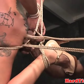 Asian sub clit stimulated while restrained