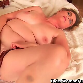 Grandma with large breasts and unshaven pussy is dildoing