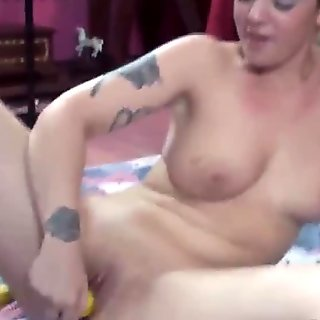 stuffs her twat with bananas