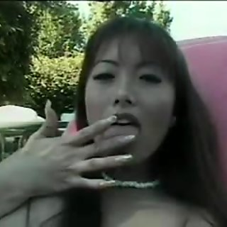 Asian girl fingers her clit