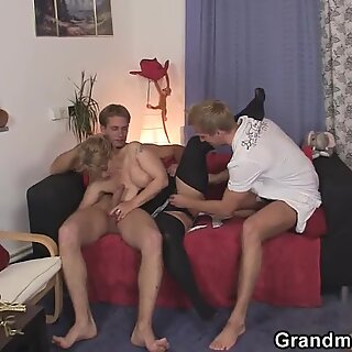 Hot old lady takes two stiff rods at once