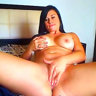 Busty Latina Babe Fingering her Cunt
