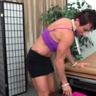 Mature muscle woman toying her huge clit