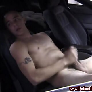 Muscular hunk jerking off in parked car