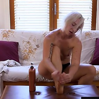Big clitted amateur toys her hairy cunt on the sofa