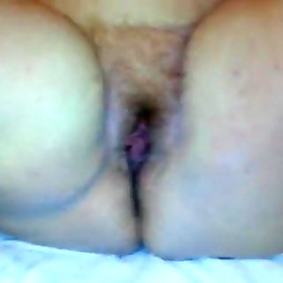 rub her fat ass and hairy meaty pussy with oil