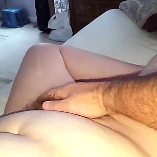 feel the clit between her legs with hairy soft pussy